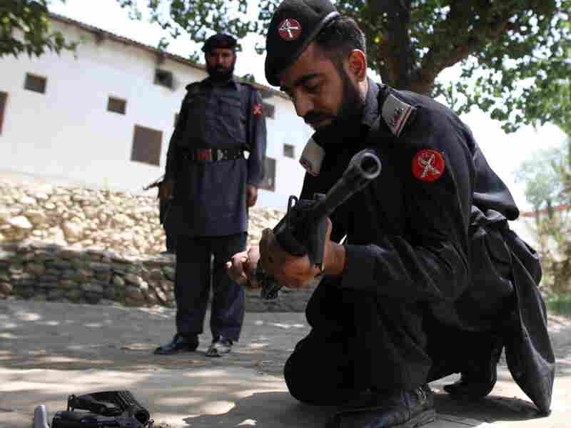 Frontier Constabulary troops return to Shabqadar Fort regularly for refresher courses on weapons and tactics. This man is assembling and disassembling a rifle under the watchful eye of his instructor.