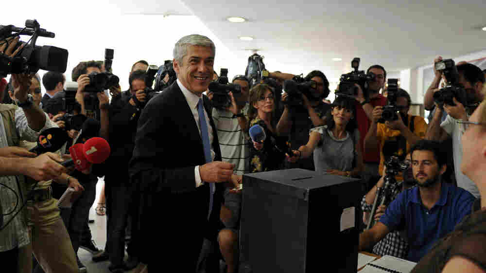 Jose Socrates, Portugal's caretaker prime minister, chats after casting his ballot at a polling station in Lisbon on Sunday. Despite his exuding self-confidence, the latest polls showed him trailing his Social Democrat Party rival, Pedro Pessos Coelho.