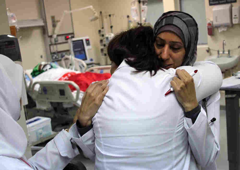 Two doctors embrace after tending to wounded protestors at Salmaniya Medical Complex on February 20, 2011 in Manama, Bahrain.