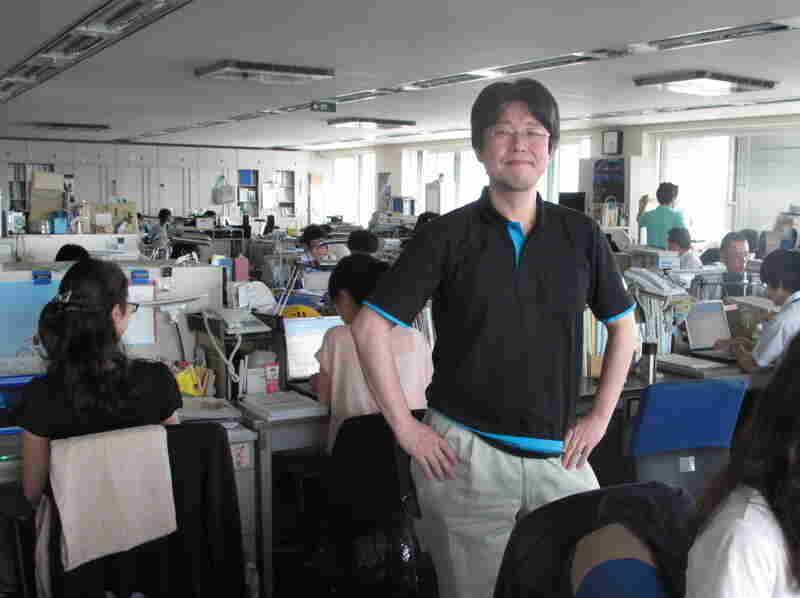 Masahiro Sato is the Environment Ministry bureaucrat charged with implementing  Super Cool Biz. Wearing a polo shirt to work is no less than a sartorial  revolution in buttoned-up Japan.