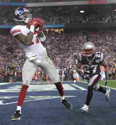 Feb. 3, 2008: then-New York Giants receiver Plaxico Burress, left, catches the game-winning touchdown pass in front of New England Patriots' Ellis Hobbs III during the final minute of Super Bowl XLII.