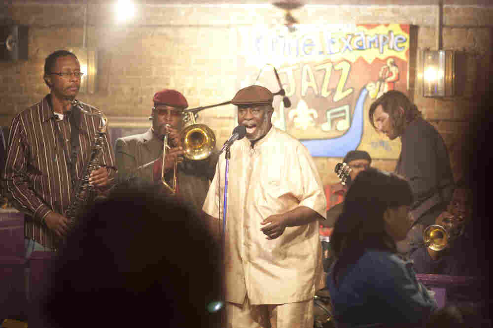 "Al ""Carnival Time"" Johnson (center, singing) sits in with Antoine Batiste and the Soul Apostles on Treme. Batiste, the trombonist, is played by Wendell Pierce."