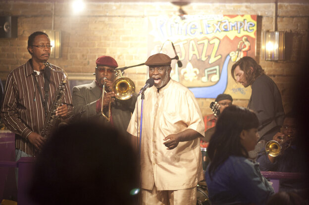"""Al """"Carnival Time"""" Johnson (center, singing) sits in with Antoine Batiste and the Soul Apostles on Treme. Batiste, the trombonist, is played by Wendell Pierce."""