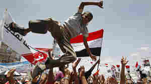 In the capital, Sanaa, on Sunday, some Yemeni anti-government protesters celebrated Saleh's departure.