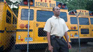 School bus driver Jamille Aine, shown here in 2008, worked for an employer in Connecticut that didn't offer paid sick days; a prolonged illness could have imperiled his ability to pay bills. A bill the state's governor has promised to sign would give workers in companies with 50 or more employees a week of paid sick time.