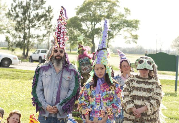 Harley (Steve Earle, left) and Annie (Lucia Micarelli, center) join the traditional Faiquetaigue courir de Mardi Gras on Treme.