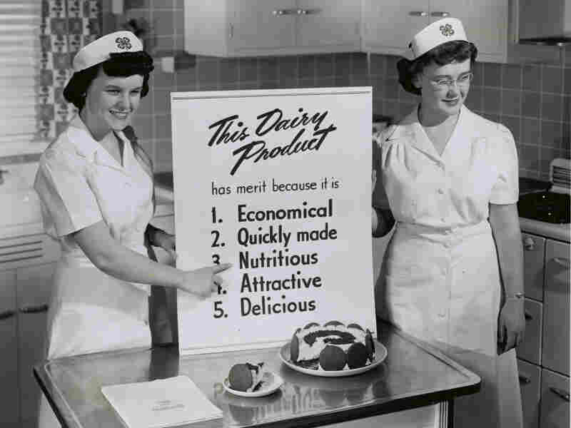 Two government nutritionists explain the merits of their dairy dessert. One of the few science jobs available to women in the 1950s was in the field of home economics.