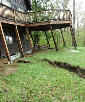 Pam Machold's home on Little Porter Mountain has been so badly twisted by the  Keene Valley landslide that local officials condemned the structure.