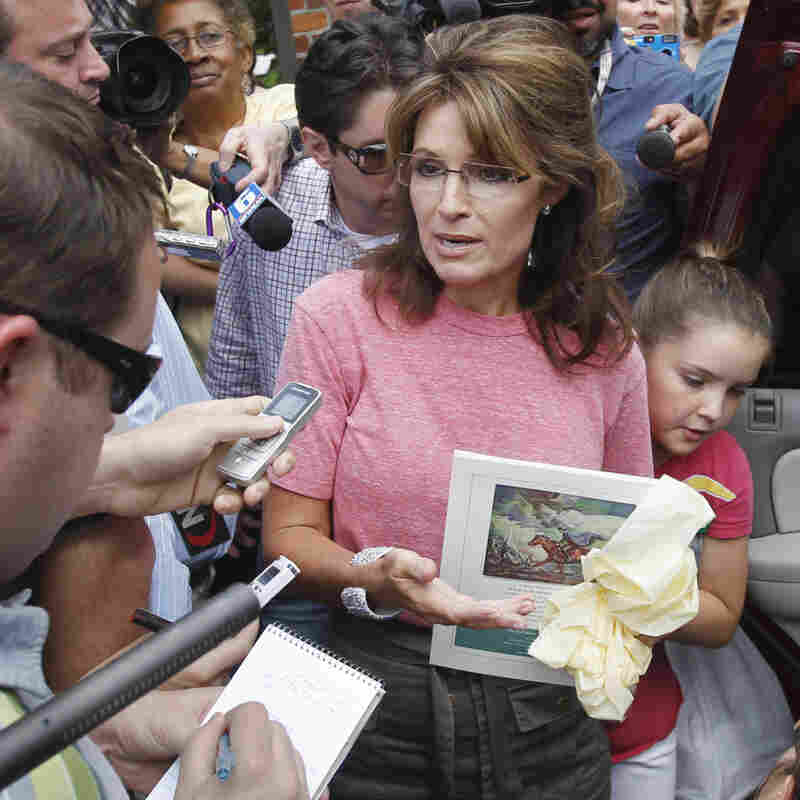 Former Alaska Gov. Sarah Palin (R), holding a booklet about Paul Revere, spoke briefly with the media as she toured Boston's North End neighborhood on June 2, 2011.