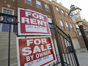 """For Sale"" and ""For Rent"" signs are seen on the front of townhomes in Centreville, Va."