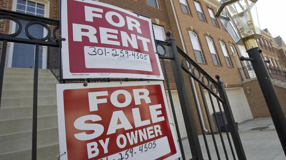 """""""For Sale"""" and """"For Rent"""" signs are seen on the front of townhomes in Centreville, Va."""