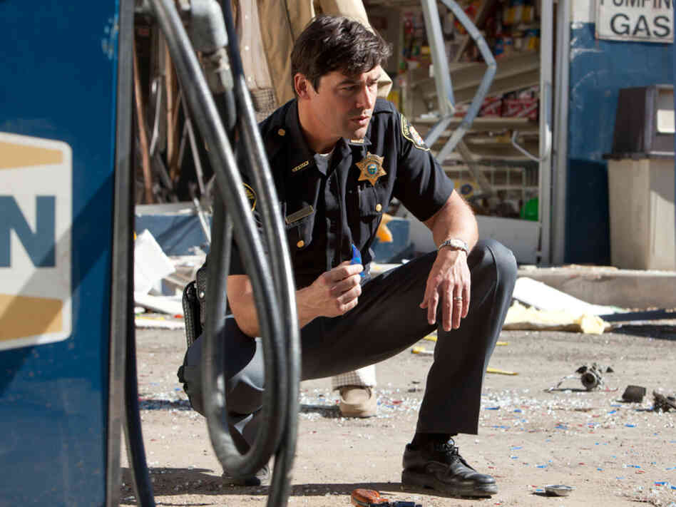 Friday Night Lights star Kyle Chandler plays lawman Jackson Lamb, whose kid stumbles onto a cover-up involving the Air Force — and a top-secret cargo that's gotten out of control.