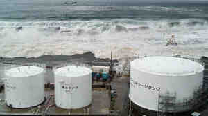 The tsunami flows over sea walls towards TEPCO's Fukushima Daiichi nuclear power plant on March 11, 2011. This photo was taken by Tokyo Electric Power Company.