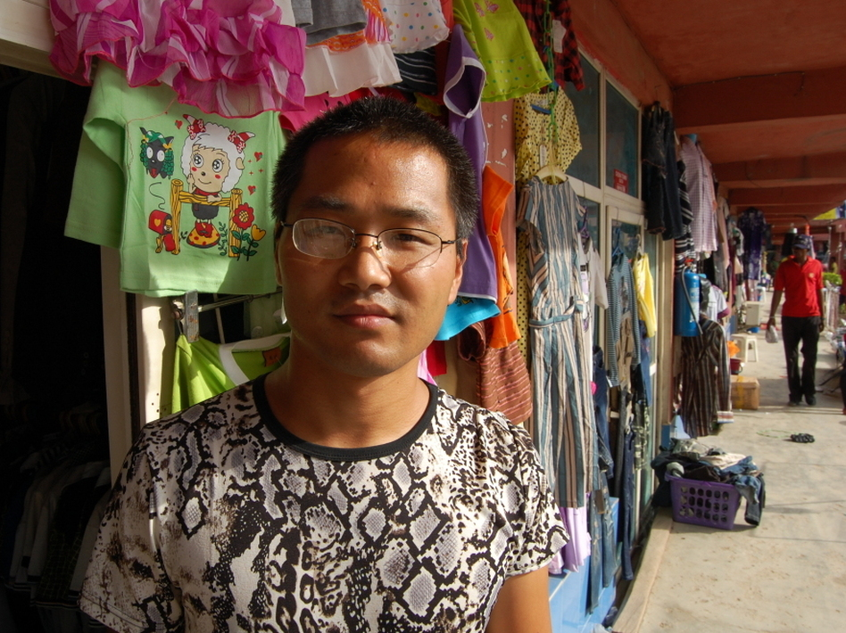 Huang Haifeng owns a shop that sells doors and men's suits. Many Nigerians see Chinese as indefatigable businessmen, but Huang says operating in Nigeria is tough. (NPR)