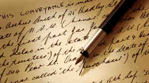 Old handwritten legal document, with fountain pen.