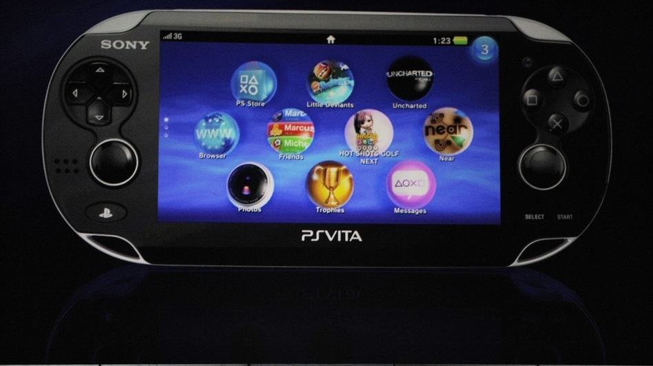 Kazuo Hirai, president and chief executive of Sony Computer Entertainment America, introduces the company's next-generation portable gaming machine, PlayStation Vita, during Monday's news conference at the E3 gaming convention in Los Angeles. The touch-interface and motion-sensitive handheld PlayStation Vita that will go on sale before the winter holidays.