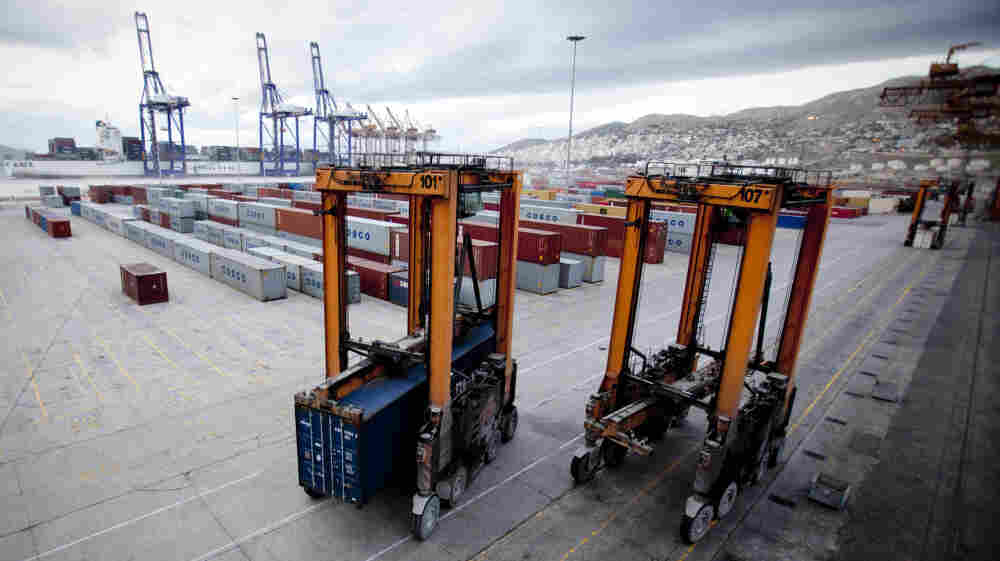 Greek dockworkers unions say there have been two accidents in one year on the Chinese-run pier at Piraeus involving straddle carriers like these, seen in December 2010. The unions say a lack of specialty training is likely to blame. The Chinese company Cosco doesn't allow unions or collective bargaining among its 500-plus Greek workers.