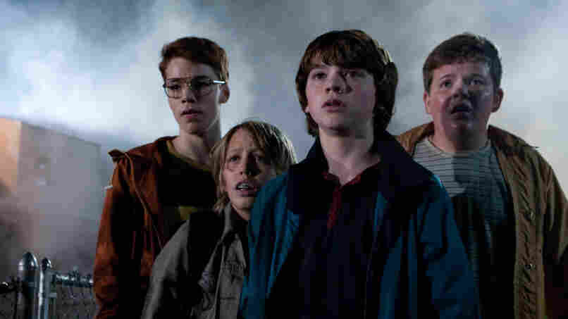 'Super' 4: Gabriel Basso (left), Ryan Lee, Joel Courtney and Riley Griffiths play teenagers shooting a homemade movie when a spectacular crash draws them into a world they weren't supposed to know about.