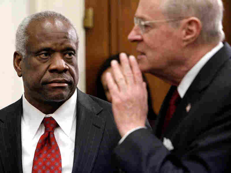 """Justice Clarence Thomas (left) has made it clear that he doesn't like the """"back and forth"""" of questioning during an oral argument. Justice Anthony Kennedy (right), on the other hand, says he loves the give and take. """"Many judges who have been trial lawyers feel that way,"""" Kennedy says. """"We wish we were down there."""""""