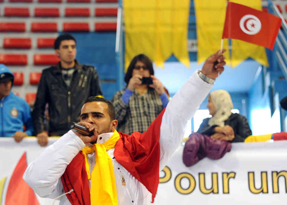 "Hamada Ben Amor, also known as ""El General,"" performs during the first meeting of Tunisia's main opposition party on Jan. 29, in Tunis."