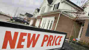 A sign shows that a new price is available on this town house for sale in Pepper Pike, Ohio, in January. Home prices are falling across most of America's largest cities, and average prices in eight major markets have hit their lowest point since the housing bust.