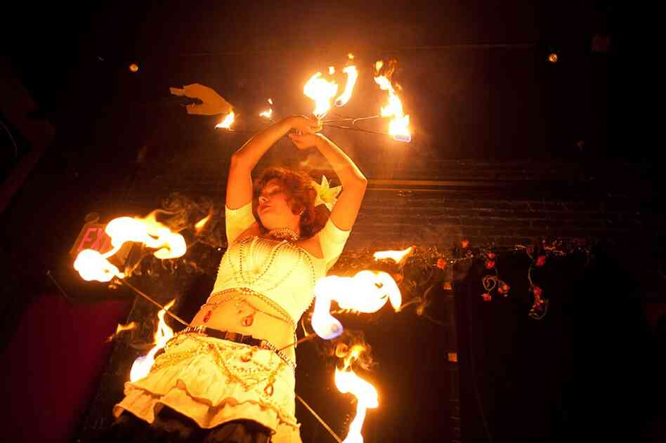 Anna Jacobson, a 24-year-old Brooklynite who enjoys fire dancing, is one of the subjects in Amira Al-Sharif's photo project.