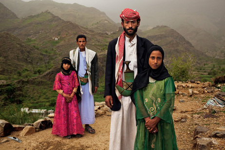 """Whenever I saw him, I hid. I hated to see him,"" Tahani (in pink) recalls of the early days of her marriage to Majed, when she was 6 and he was 25. The young wife posed for this portrait with former classmate Ghada, also a child bride, outside their mountain home in Hajjah, Yemen."