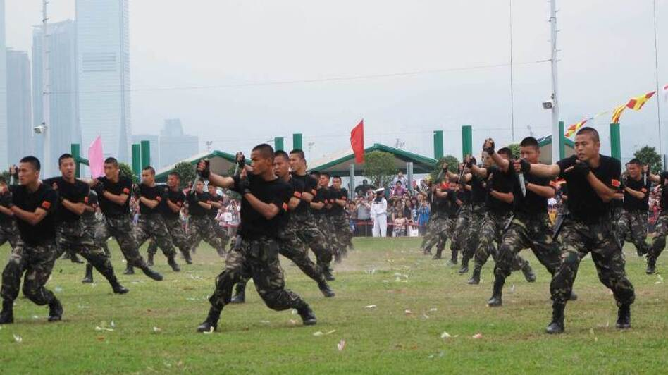 Stonecutters Island army base in Hong Kong opens to the public once a year as a goodwill gesture. Displays include kung fu demonstrations and shows of knife-fighting skills. (NPR)
