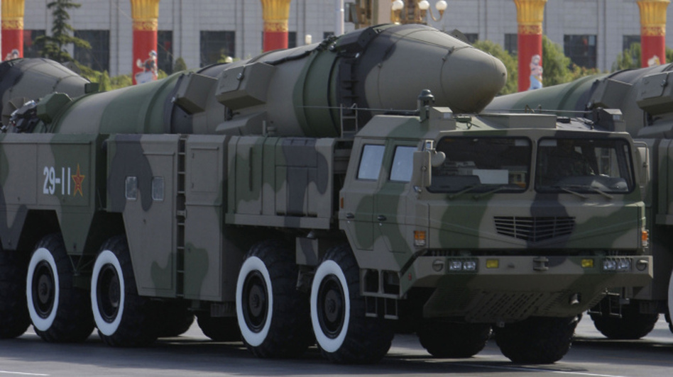 "Chinese military vehicles carry the Dong Feng 21D ""carrier killer"" missile during a military parade in Beijing on Oct. 1, 2009. The missile under development is designed to be launched from land to hit a carrier hundreds of miles away. ""Though still unproven (and some analysts say overrated) no other country has such a weapon,"" reports The Associated Press. (AP)"