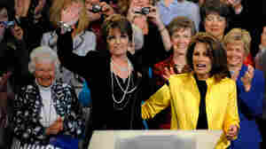 Former Republican vice presidential nominee Sarah Palin (left) waves to the crowd after a campaign appearance in Minneapolis for Rep. Michele Bachmann (R-MN) on April 7, 2010.
