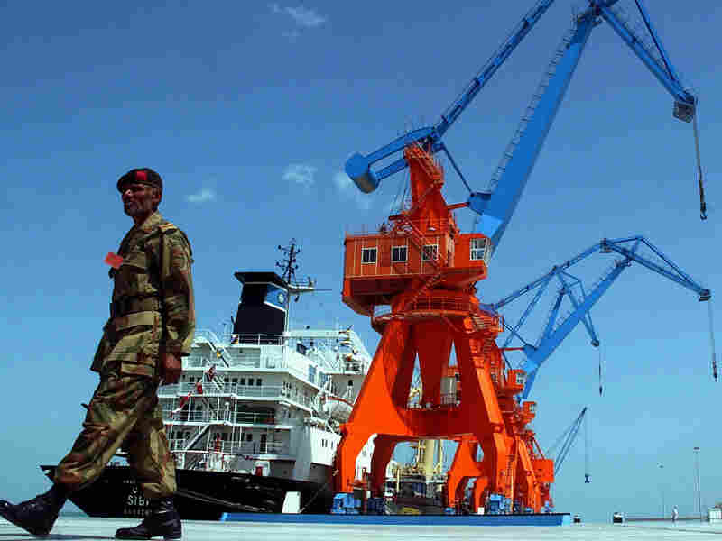 A Pakistani soldier patrols the Gwadar port in  southwestern Pakistan in 2007. Eighty percent of the port's initial funding was provided by China.