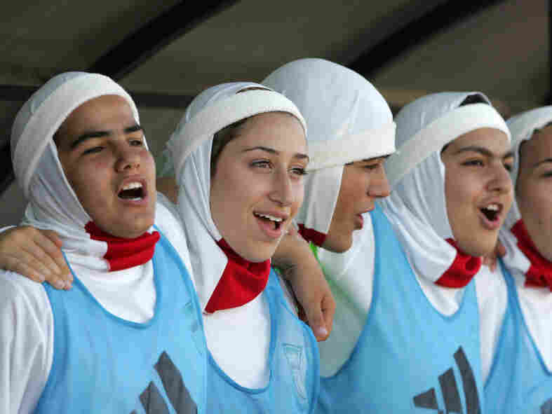 Members of the Iranian women's football team wear the traditional hijab as part of their uniform in 2007. On Sunday, FIFA disqualified the Iranian team from the Olympic qualifier stating uniform violations.