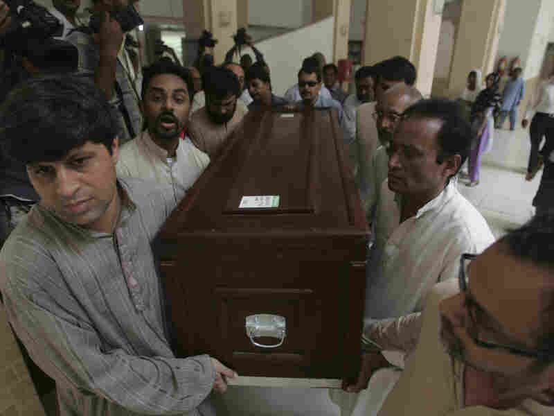 People carry the coffin of Pakistani journalist Saleem Shahzad at Karachi airport in Pakistan on June 1. In his final story, Shahzad quoted anonymous sources who linked an attack on a naval base to the discovery of suspected  al-Qaida operatives inside the navy itself.