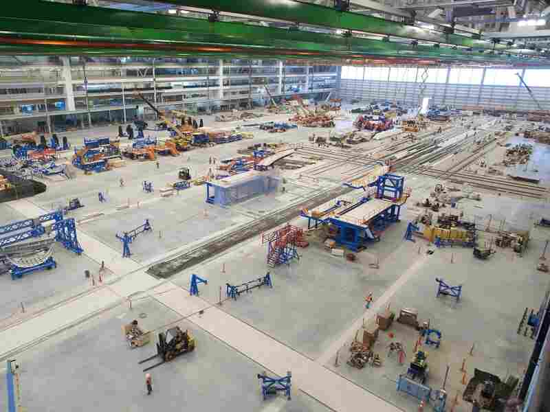 Construction crews work to finish Boeing's new 787 Dreamliner assembly  plant in North Charleston, S.C. The company plans to hire 1,000 nonunion workers and start assembling planes in July.