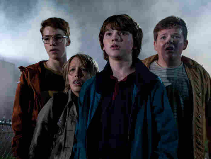 "Gabriel Basso (from left), Ryan Lee, Joel Courtney and Riley Griffiths star as the young movie makers. It ""took forever"" to cast the film, Abrams says, but the minute the kids got on set, ""they had a wonderful dynamic."""