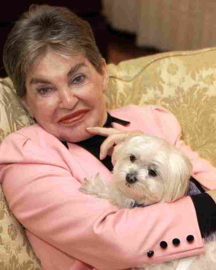 Leona Helmsley and her dog Trouble at the Park Lane Hotel in New York City on Jan. 31, 2003. (AP Photo/Jennifer Graylock)