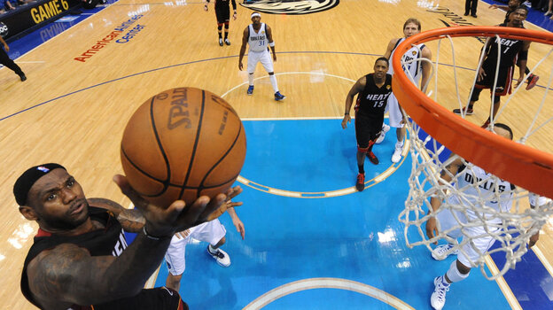 Miami Heat's LeBron James goes up for a shot during the second half of Game 5 of the NBA Finals against the Dallas Mavericks on June 9, 2011. The Mavericks won 112-103 to take a 3-2 lead in the series.