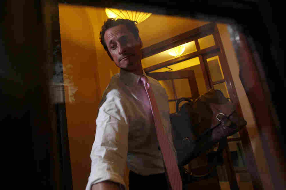 Democratic Rep. Anthony Weiner closes the front door of his building when arriving home in New York, on Thursday.