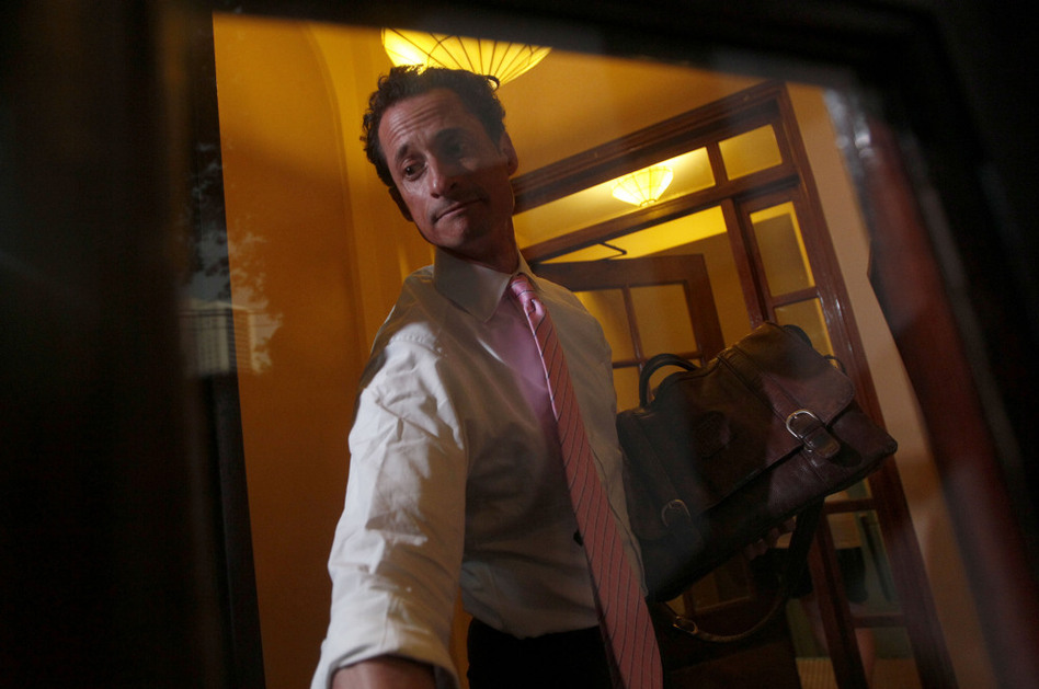 Democratic Rep. Anthony Weiner closes the front door of his building when arriving home in New York, on Thursday. (Mary Altaffer/AP)