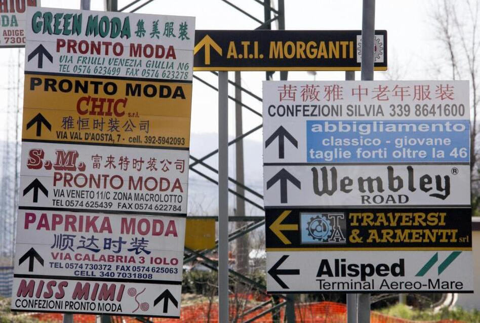 Street signs cater to the languages spoken in Prato. (AFP/Getty Images)