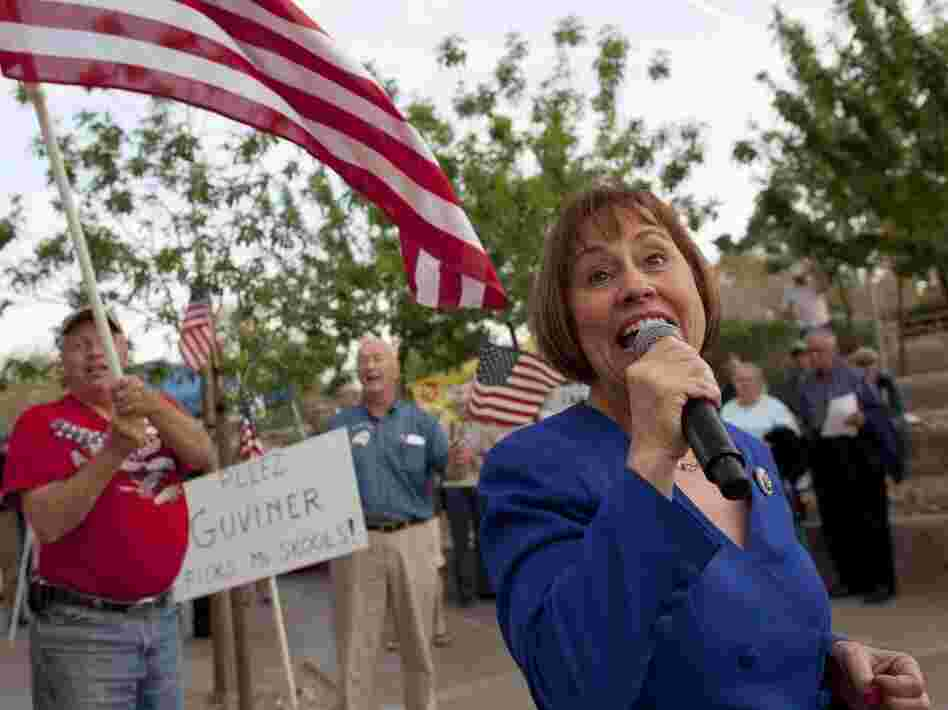 Sharron Angle, right, sings during a rally by Tea Party supporters pm April 15 in Las Vegas. Hundreds of tea party supporters rallied in northern and southern Nevada on Friday to urge lawmakers not to raise taxes.