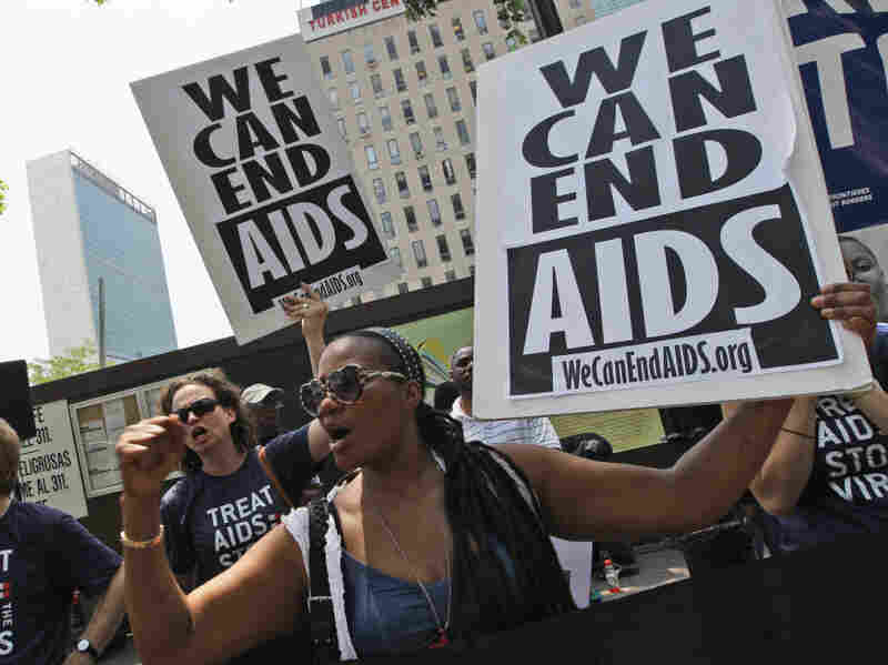 Cassandra James, right, Emily Bass, and Mitchell Warren chant slogans during a demonstration Wednesday in New York.  Activists from around the world rally outside the United Nations headquarters calling for full funding for global AIDS treatment and prevention.