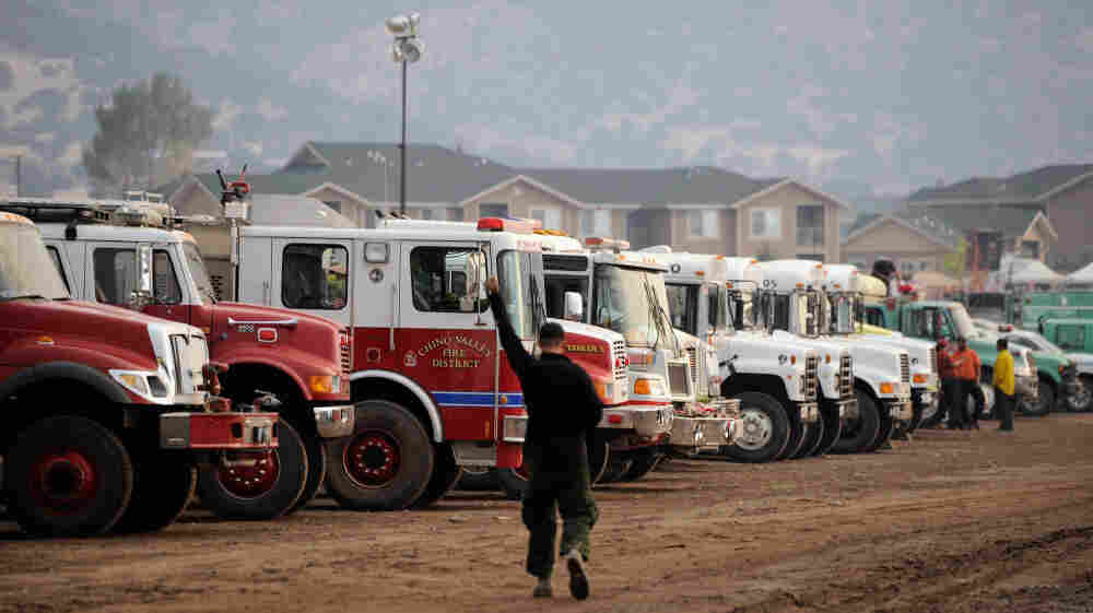 Crews prepared to head out to fire lines to battle the Wallow fire near the Arizona town of Eagar. The town's residents were ordered to leave their homes earlier this week.