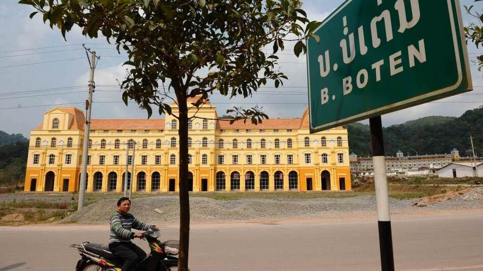 The town of Boten in northern Laos along the Chinese border will be the first stop for high-speed trains outside China. Local government officials hope the train will help boost the local economy by bringing tourists who will stay at hotels like this one, currently under construction. (AFP/Getty Images)