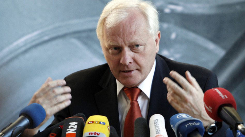 Reinhard Burger, president of the Robert Koch Institute, tells reporters in Berlin Friday that sprouts from a German farm are the cause of the country's massive foodborne illness outbreak. (AP)