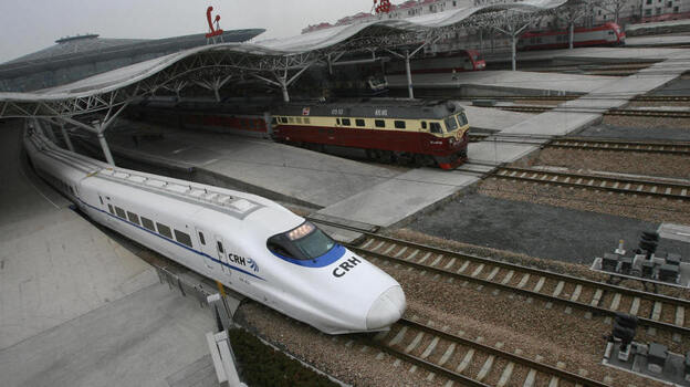 The CRH2 China Railways high-speed bullet train, departing a Shanghai station in February 2007, is capable of speeds of more than 150 mph. (AFP/Getty Images)