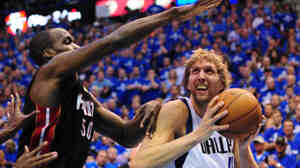 Dirk Nowitzki of the Dallas Mavericks is defended by Joel Anthony of the Miami Heat during Game 5 of the NBA Finals at the AmericanAirlines Center in Dallas on Thursday (June 9, 2011).