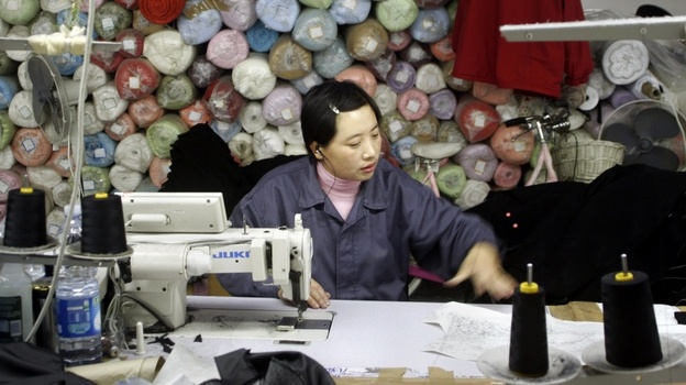 A Chinese employee works in a textile firm in the Macrolotto area in Prato, the biggest textile district in Europe, in 2005. The town has become home to the largest concentration of Chinese residents in Europe — many of whom are not legal. (Gamma-Rapho via Getty Images)