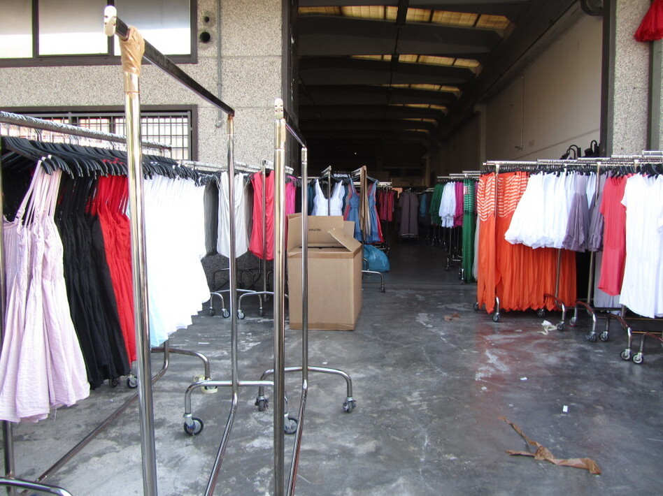 At the Macrolotto industrial park, home of pronto moda — or fast fashion — warehouse after warehouse is filled with racks of low-end, trendy women's garments. (NPR)