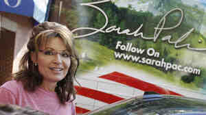 Former Alaska Gov. Sarah Palin stands near her tour bus outside a hotel in Boston on June 2.
